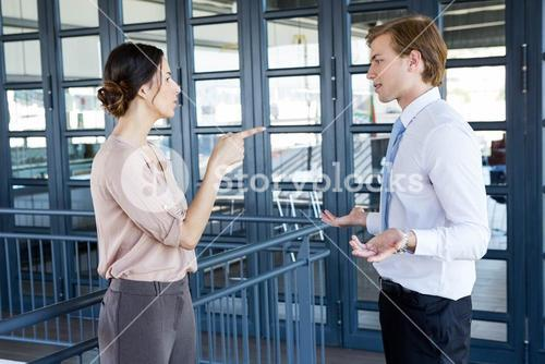 Two young business colleagues having an argument
