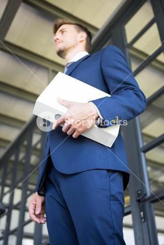 Businessman holding file with documents