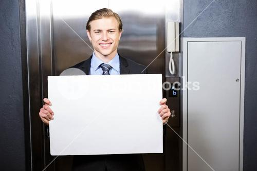 Businessman holding a signboard