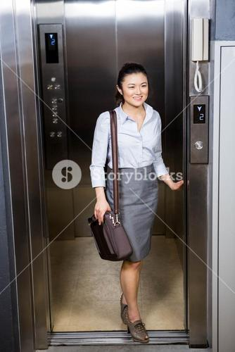Businesswoman standing in an elevator