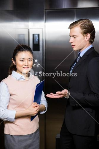 Businessman interacting with businesswoman