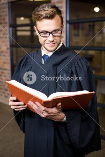 Lawyer reading law book near library