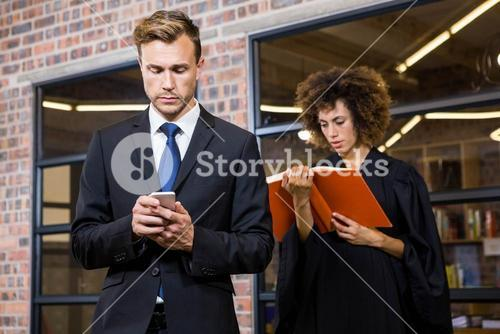 Businessman text messaging on smartphone