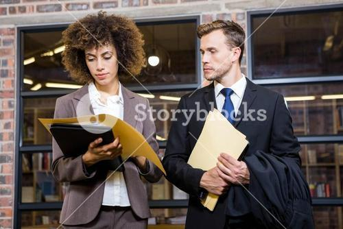 Lawyer and businesswoman looking at documents