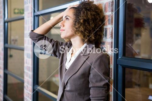 Frustrated businesswoman with hand on forehead