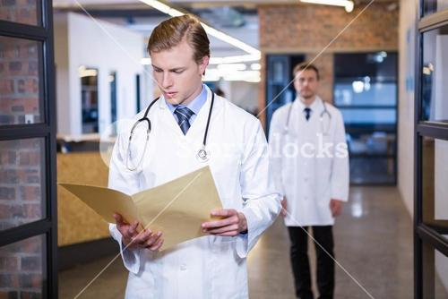 Doctor checking a medical report