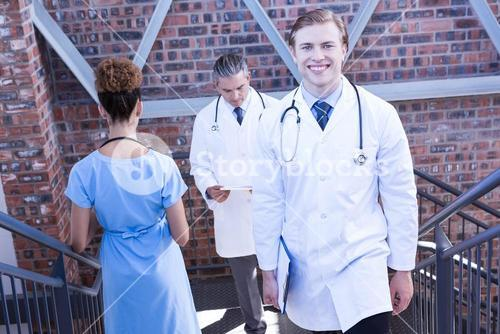 Doctors walking on staircase