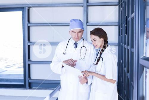 Doctors checking a medical report