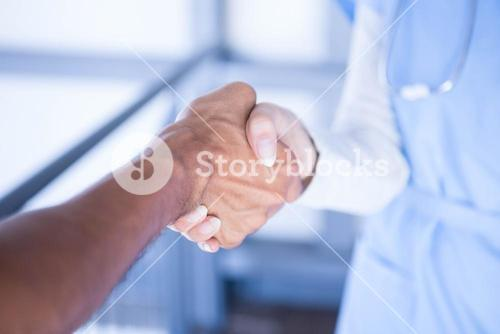 Doctors shaking hands in corridor