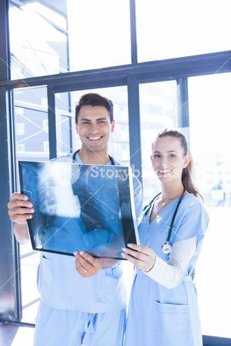 Medical team examining x-ray