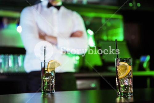 Two glasses of gin on bar counter