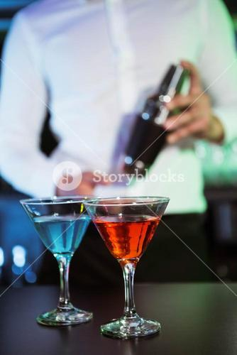 Two glasses of cocktail on bar counter