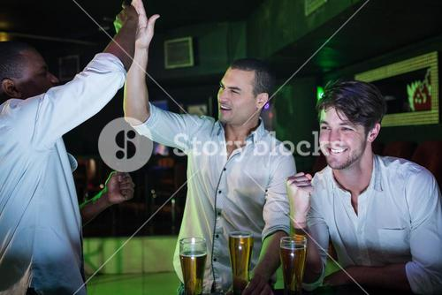 Group of men partying with glass of beer