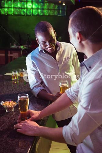 Two men having beer at bar