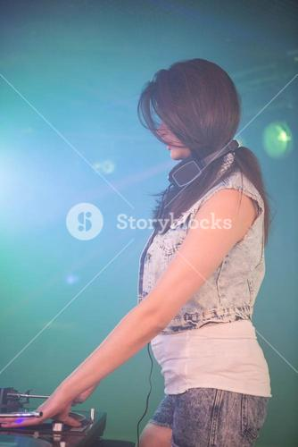 Female DJ playing music