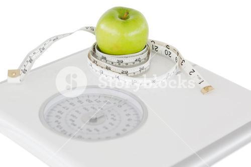 Green apple circled with a tape measure and a weighscale