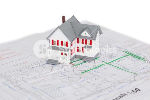 Toy house model on a plan