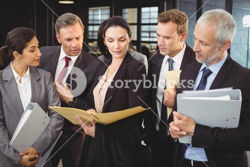 Lawyer looking at documents and interacting with businesspeople