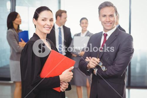 Businessman standing with lawyer