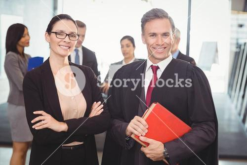 Businesswoman standing with lawyer