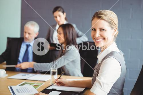 Confident businesswoman in business meeting