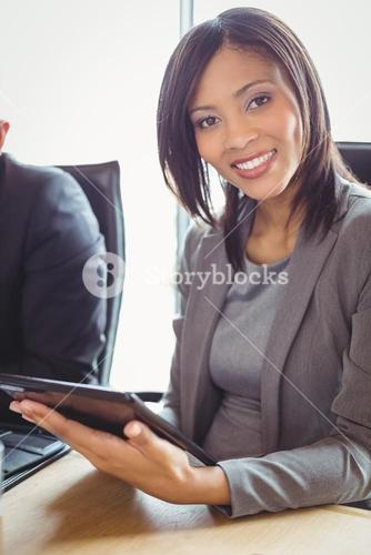 Attractive businesswoman using digital tablet