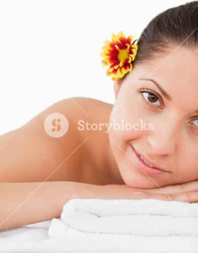 Brownhaired woman with a flower on her ear