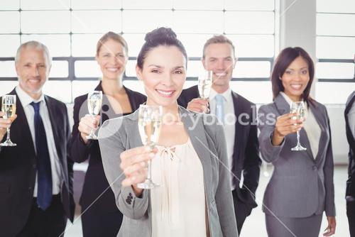 Portrait of business team holding champagne flute