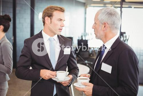 Businesspeople having a discussion during break time