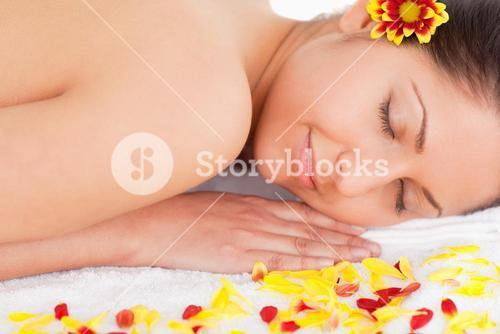 Darkhaired woman surrounded by flowers