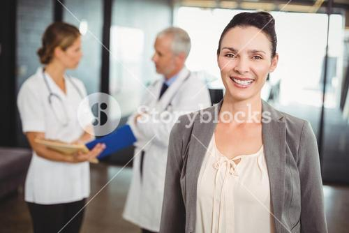 Portrait of smiling businesswoman in hospital