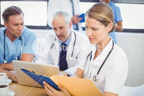 Female doctor looking at medical report