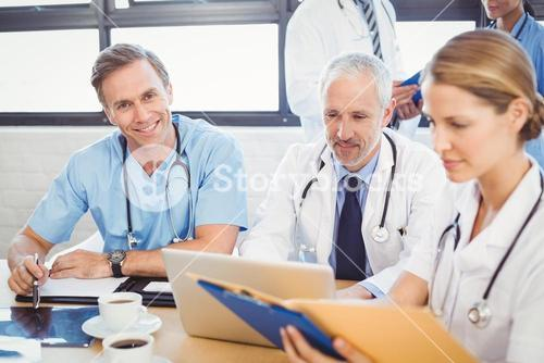 Male doctor smiling in conference room