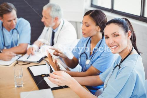 Portrait of female doctor smiling in conference room