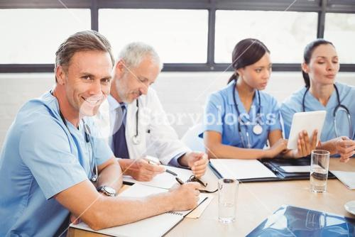 Portrait of male doctor smiling in conference room