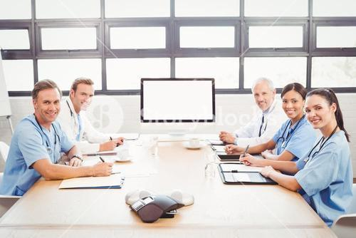Portrait of happy medical team in conference room