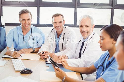 Portrait of doctors smiling in conference room