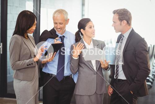 Businesspeople interacting in office