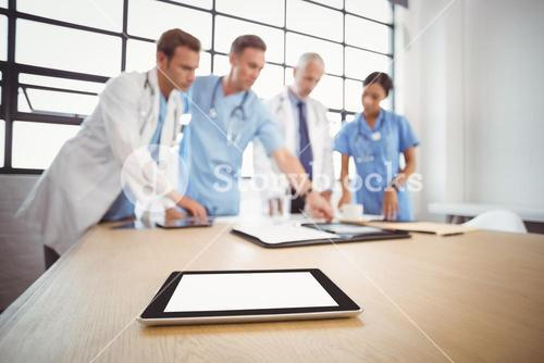Digital tablet on table in conference room