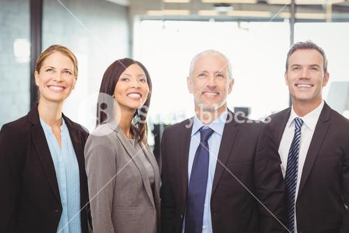 Businesspeople looking up and smiling