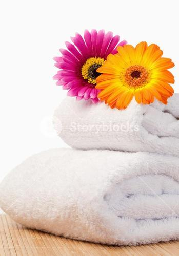 Fuchsia and orange sunflovers on white towels