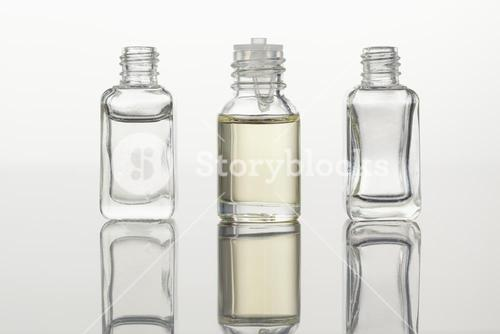 Glass flasks against a white background