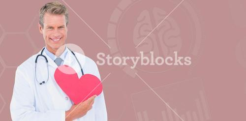 Composite image of smiling male doctor holding heart shape card