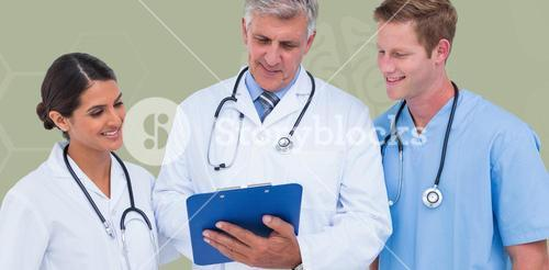 Composite image of doctor working with colleagues while holding writing pad