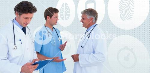 Composite image of team of serious doctors discussing