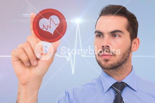 Composite image of businessman measuring something with his fingers