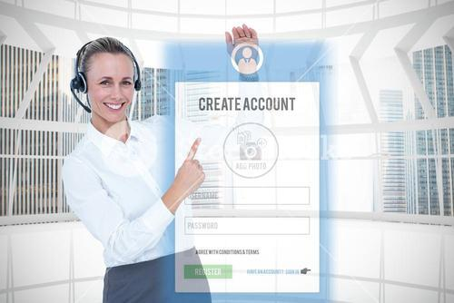 Composite image of smiling businesswoman with headset pointing