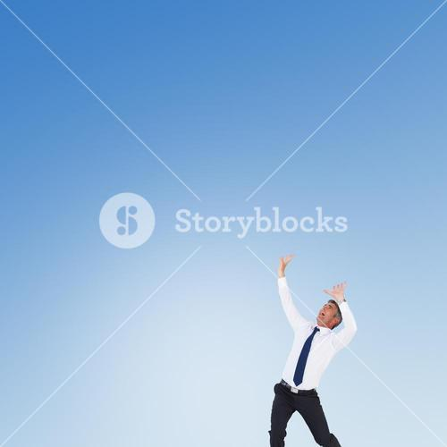 Composite image of businessman with hands raised on white background