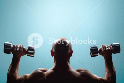 Composite image of rear view of muscular man lifting dumbbells