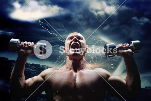 Composite image of aggressive bodybuilder lifting bumbbells